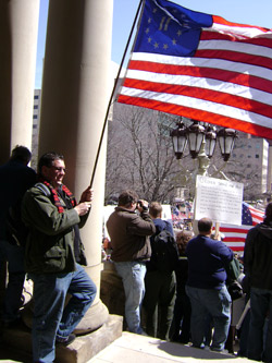 Jeff McQueen holding the Flag at the Lansing Tea Party Rally
